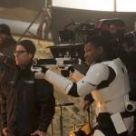 Star Wars: The Force Awakens  L to R: Director J.J. Abrams on set w/ John Boyega (Finn).  Ph: David James  ©Lucasfilm 2015